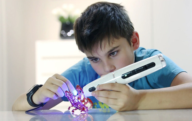 3D printing toys: Kid using a 3D Polyes Q1 pen.