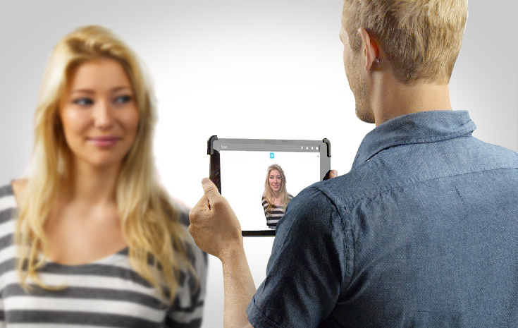 3D scanning a person with a tablet sensor.