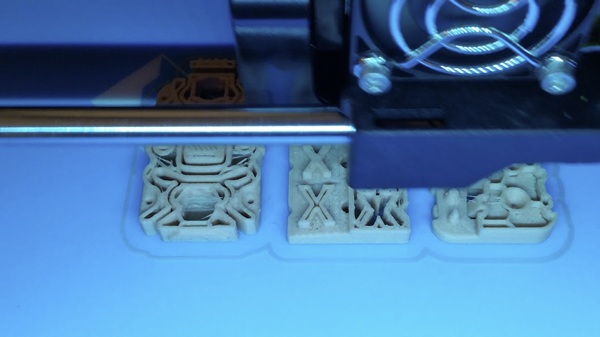 3D printing Woodfill PLA at 230C, before it was permanently stuck to the build surface.