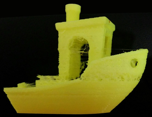 The result of an irregular extrusion speed. Weak layers and extra unwanted plastic threads
