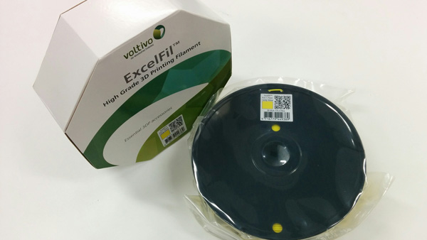 A filament spool of Voltivo ExcelFil PLA inside its vacuum sealed plastic bag. QR codes are clearly visible.