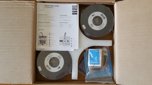 Ultimaker 2+ instruction manual and filament spools.