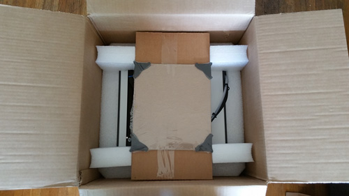 Inside the Ultimaker 2+ cardboard packaging.