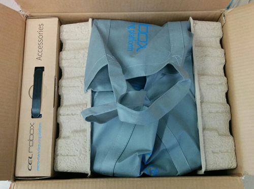 Inside the CEL Robox cardboard packaging. On the left the accessories box, on the right the 3D printer.