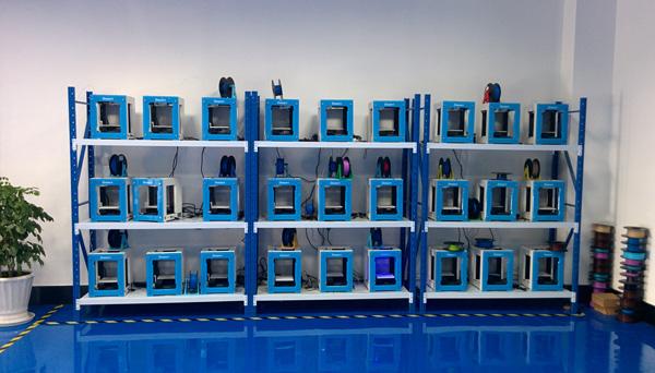 A wall of EinStart-S desktop 3D printers.