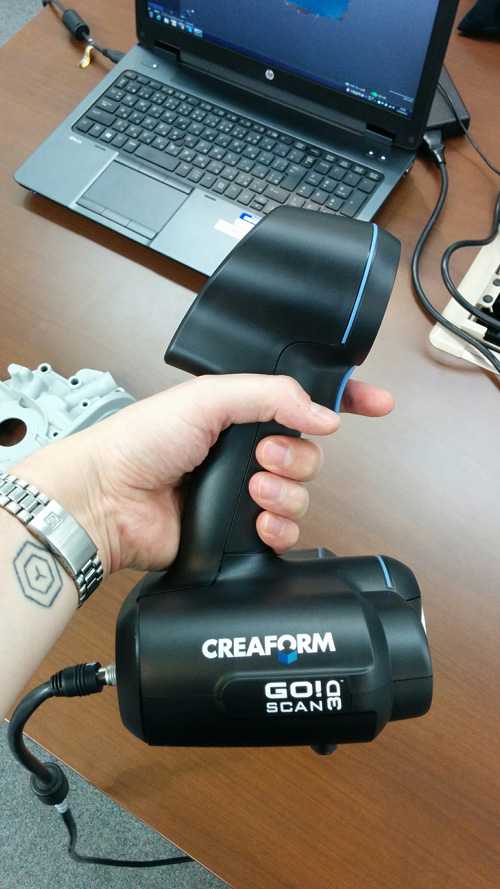 Close up of the Creaform Go!SCAN 50 in hand.