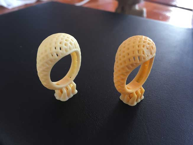 Our two test ring prints. The one on the right has a small dent because we took it off the build platform with our fingers instead of the scraper